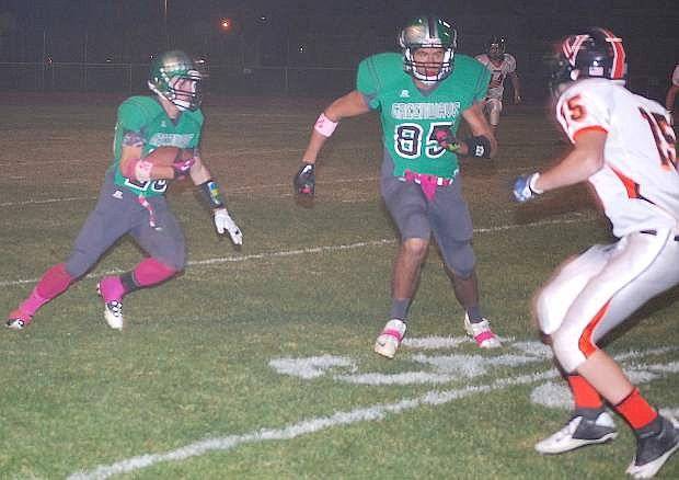 Fallon wide receiver Tyler Bagby, left, looks to run as Beau Marshall (85) blocks during the Greenwave's 49-6 win over Fernley on Friday at the Edward Arciniega Complex.