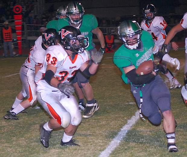 Fallon running back Trent Tarner attempts to avoid a Fernley defender in last week's 20-12 Northern Division I-A playoff win. The Greenwave host undefeated Moapa Valley at 1 p.m. Saturday.