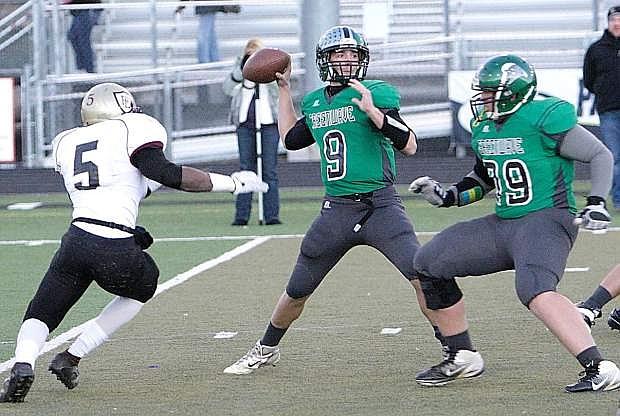 Fallon quarterback Morgan Dirickson prepares to throw as lineman Brennan Lewis looks to block Faith Lutheran's Danny Otuwa during the 2013 Division I-A title game.