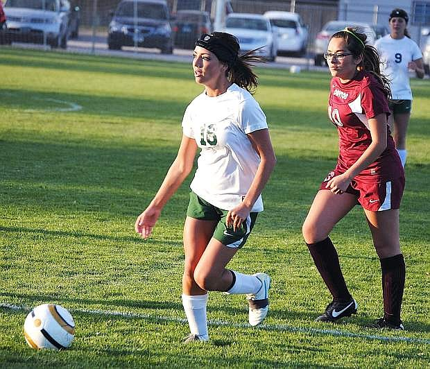 Fallon's Kayla Biggs dribbles past a Dayton defender during Tuesday's 6-0 win at the Edward Arciniega Complex.