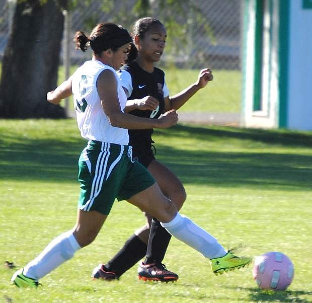 Fallon's Alexis Duenas fires a shot and scores during the Lady Wave's 9-0 win over Fernley on Wednesday.