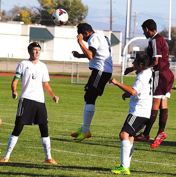 Fallon forward Fidel Endriquez heads the ball out of the box as teammates Corbin Waite (8) and Michael McCormack look on during the Wave's 4-0 loss to Sparks on Tuesday.