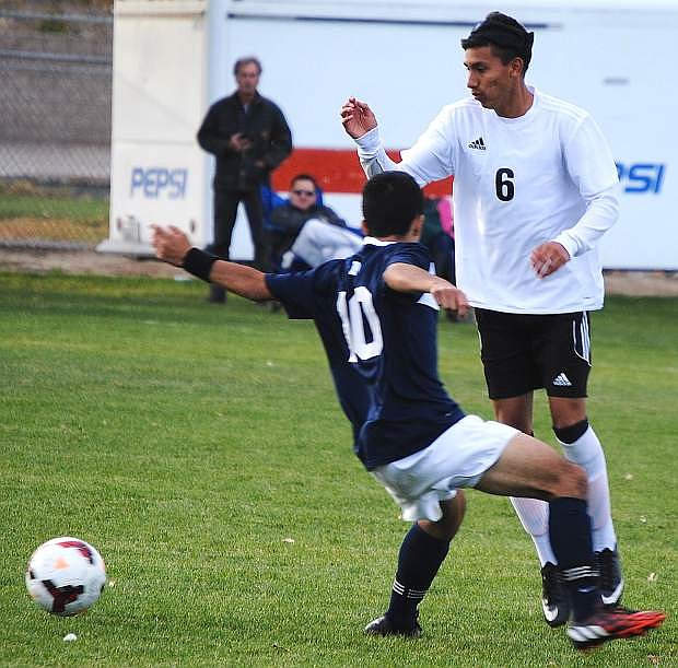 Fallon's Pedro Barajas sidesteps North Tahoe's Omar Cerda during the clubs' 2-2 tie on Tuesday at the Edward Arciniega Complex.