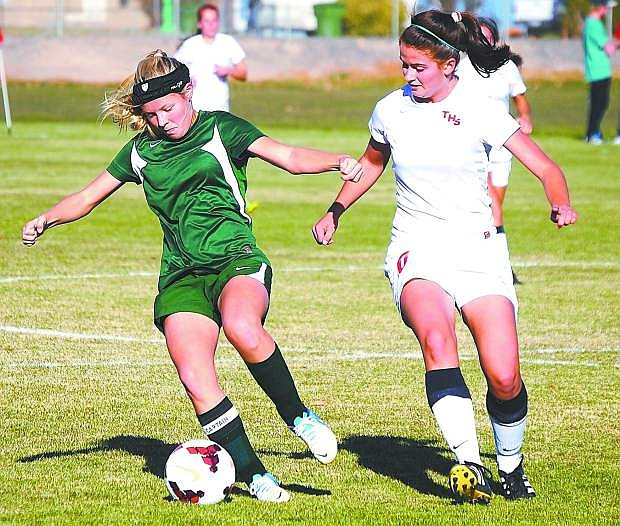 Fallon's Sam Burton fight off a Truckee defender during the Lady Wave's 3-0 loss in Saturday's Northern Division I-A quarterfinal match at the Edward Arciniega Complex.
