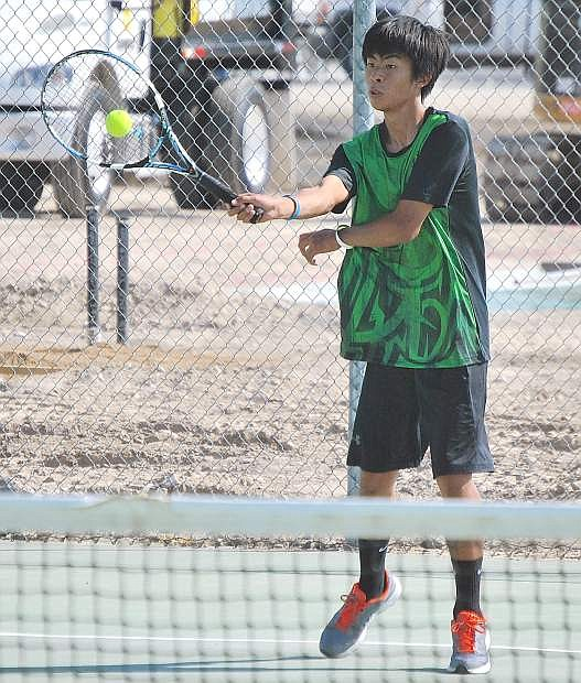 Fallon senior tennis player Wei Deng returns a shot during a match against North Tahoe on Tuesday. The Greenwave won the match 10-8.