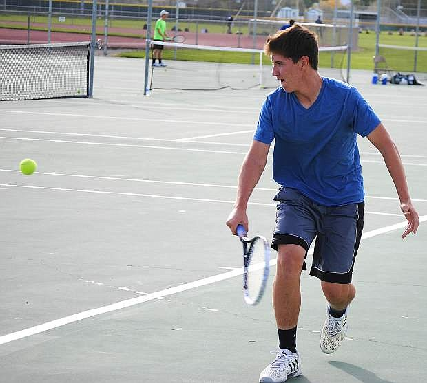 Fallon singles player Adam Wadsworth hits a backhand shot during practice on Tuesday. He competes in today's Division I-A state tournament in Truckee.
