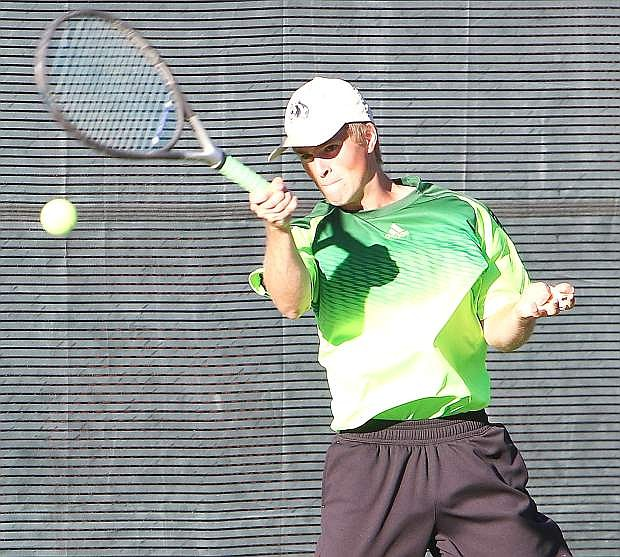 Fallon doubles player Tyler Wood returns a shot during his first-round match at the Division I-A state tournament in Truckee last week.
