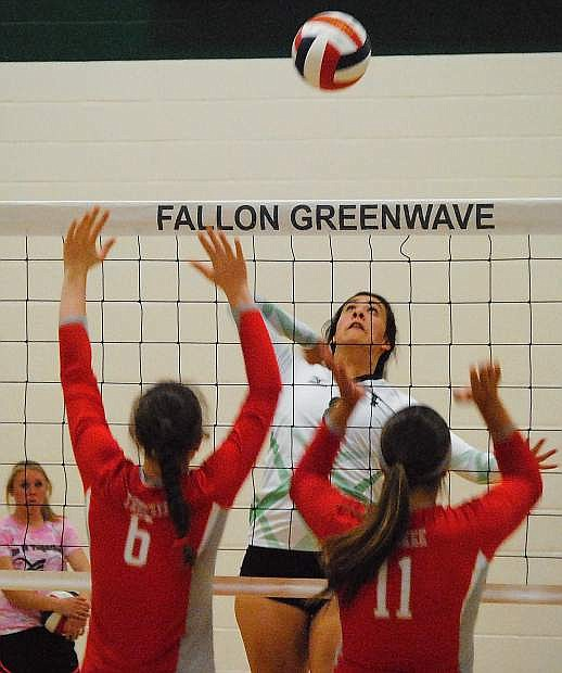 Lady Wave hitter Kristyn Arvizo goes up for the kill during Tuesday's 3-0 loss to Truckee.