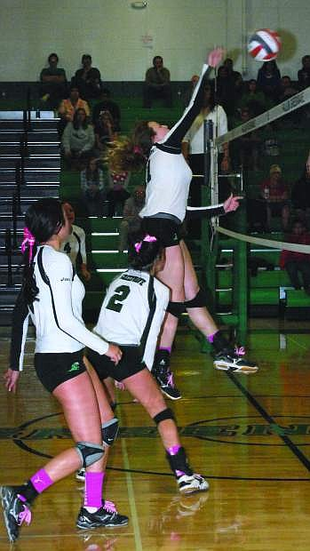 Fallon's Evan Matheson, right, spikes the ball during a match this season as Taylor Amezquita (2) and Ali Tedford, left, look on. The Lady Wave beat South Tahoe in five sets on Saturday.