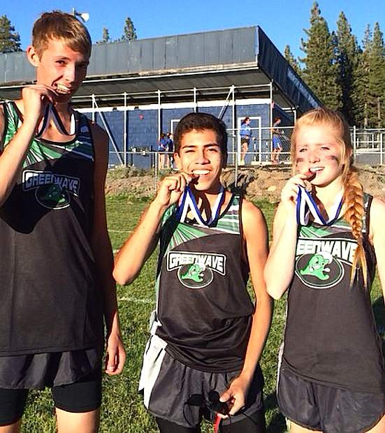 Fallon cross country runners from left Tristen Thomson, Ethan Smith and Chloe Overlie show off their medals from the North Tahoe Invitational last week.