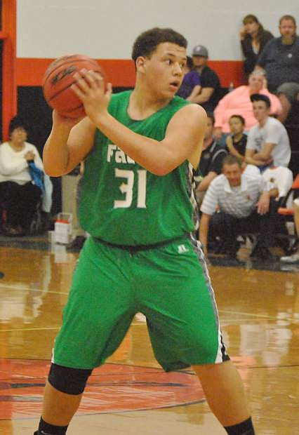 Fallon's Kaleel Rickerson (31) looks to pass while guarded in the game against Fernley.
