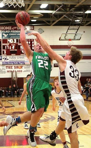 The Wave's Cade Vercellotti (22) jumps high for a basket in Fallon's previous game against Elko on the road.