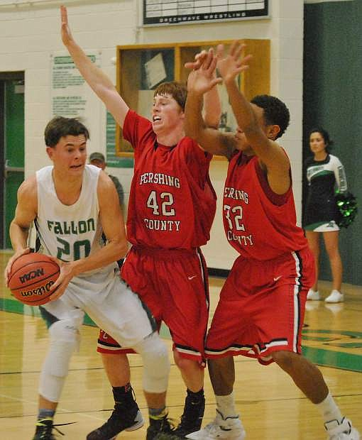 Fallon's Clay Davidson, left, struggles while guarded by the Mustangs Tuesday night.