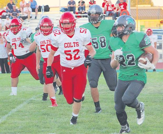 Cade Vercellotti (22) of Fallon rounds the left side to pick up a chunk of yardage against Wooster Friday night.