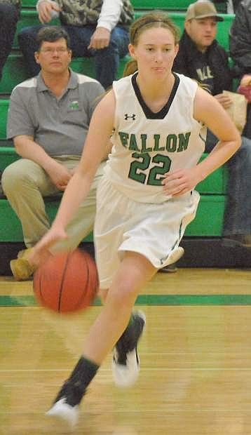 The Lady Wave's Caitlyn Welch (22) takes the ball to the hoop.