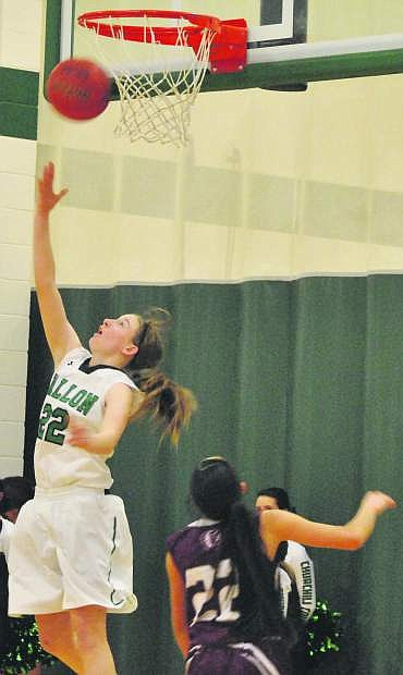 Fallon's Caitlyn Welch (22) scores a backwards layup in the Wave's dual weekend victories.