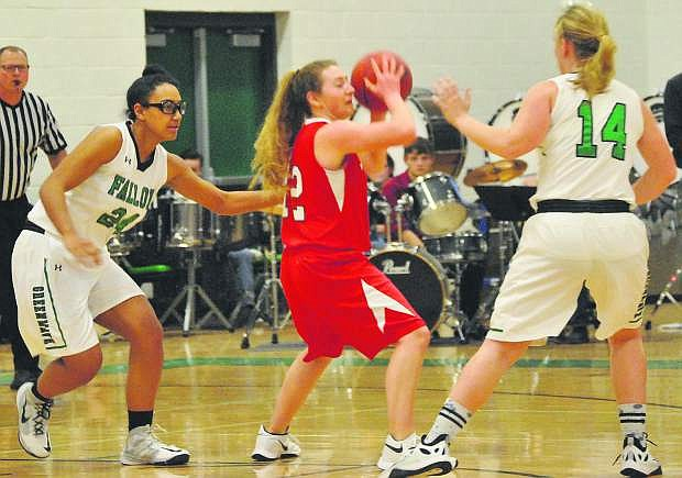 Fallon's Leta Otuafi (24) and Megan McCormick (14) gang up on Truckee's Marlena Montano (12).