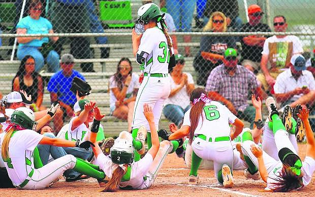 Fallon's Faith Cornmesser stands at home plate, greeted to an enthusiastic display after a home run by the Lady Wave.