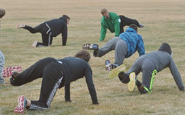 Fallon's Tristen Thomson, green, leading the Greenwave varsity track team in practice last week.