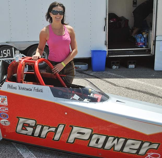 "Melissa ""Westerman"" Fredrick stands with her Girl Power dragster on Saturday after her first qualifying time."