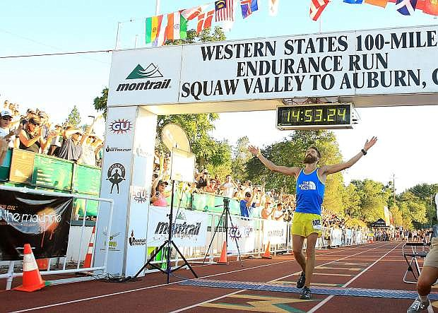 Rob Krar of Flagstaff, Ariz., crosses the finish line of the Western States 100-Mile Endurance Run last June. Krar took the win with a time of 14 hours, 53 minutes, 22 seconds, which was the second fastest time in event history. Krar will look to defend his title this weekend.