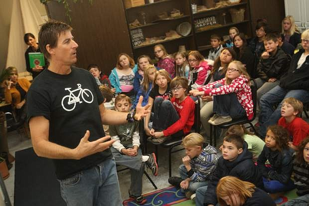 Photographer and cyclist Rick Gunn talks to students at Carson Montessori School in mid November about his Wheels for Peace program and how he would like to get them involved.