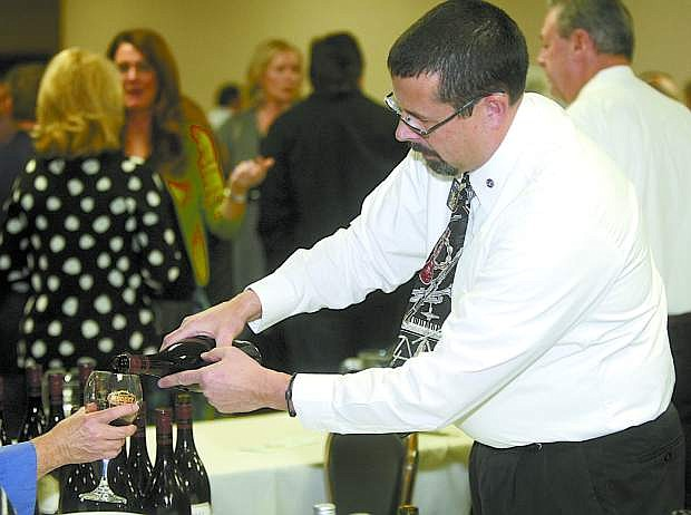 Stevan Lyon of the Carson City Kiwanis Club pours during the Winter Wine & All That Jazz event last year.