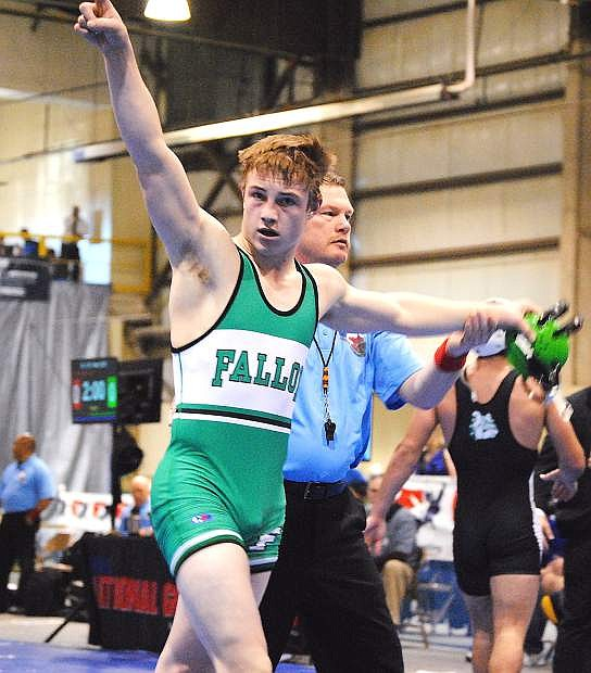 Fallon junior Sam Goings points to crowd after wininng his second consecutive state title during Saturday's Division I-A state wrestling tournament in Winnemucca.