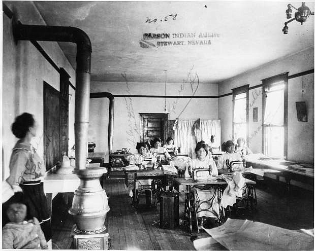 Students at Stewart Indian School Leaning sewing in about 1900.
