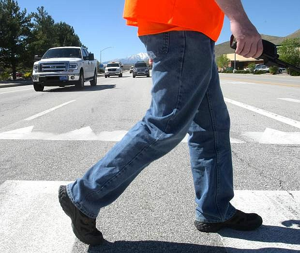 Deputy Darin Riggin crosses Stewart Street during a pedestrian saftey awareness program in May 2015.