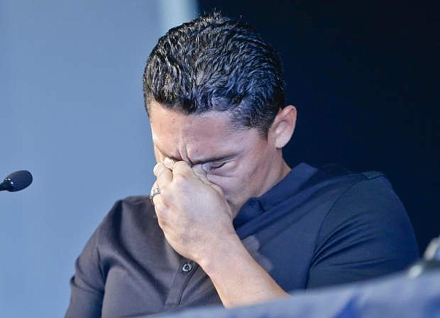 San Diego Padres shortstop Everth Cabrera, who was suspended by Major League Baseball for 50 games, breaks down while addressing the media during a news conference in San Diego, Monday, Aug. 5, 2013. (AP Photo/Lenny Ignelzi)