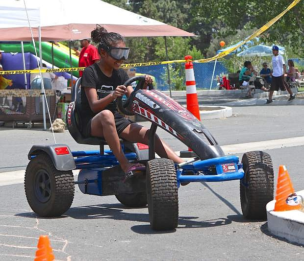 Chalina Barriga, 11, wears the 'drunk goggles' and attemptsto navigate an obstacle course in a go-cart Saturday at Youth Awareness Day, an event hosted by the Washoe Tribe Police Department.