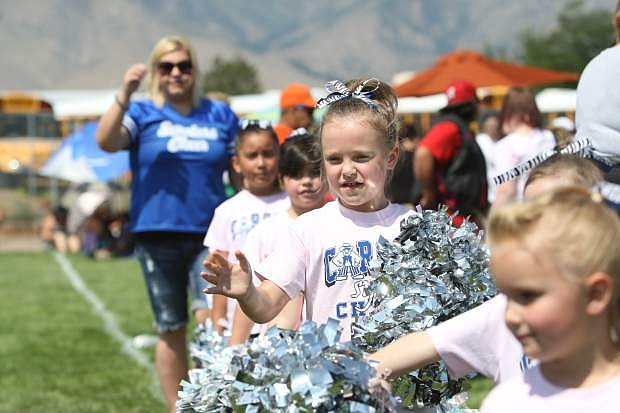 A Carson cheerleader supports her team on Saturday at the SYFL Experience.