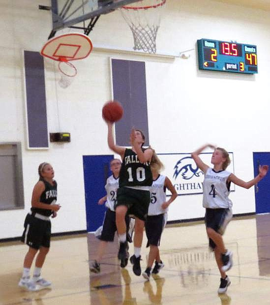 Fallon eighth grader Kenna Hamlin shoots the ball during the Lady Wave's game against Silver Stage this week.