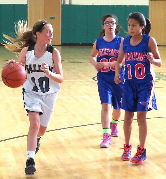 Fallon eighth-grade basketball player Kenna Hamlin drives past a pair of Eagle Valley defenders during a recent game.