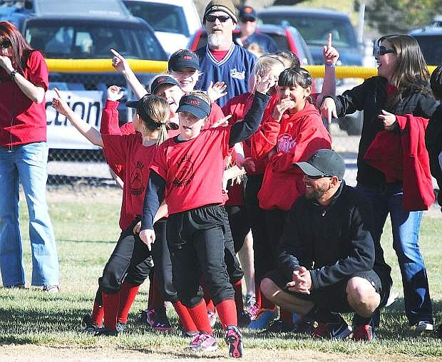 Children dance during Saturday's Opening Ceremony for the Churchill County Softball Association at the North Maine Softball Fields.