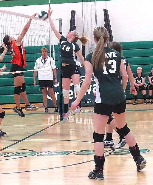 Lady Wave eighth-grader Jordan Beyer (18) makes a play on the ball during last week's match against Silverland (Fernley) as Hanna Hitchcock looks on.