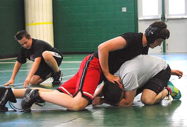 Fallon's Gabe Hardy works on his moves with assistant coach Dan Shaw during Monday's practice.