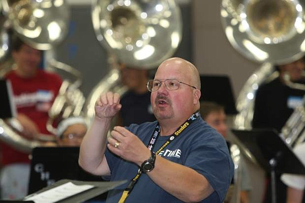 Carson High School band director Bill Zabelsky conducts band camp on Monday.
