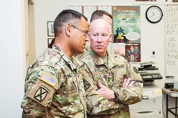 Maj. Gen. Glen Moore, the Deputy Commanding General for the U.S. Army National Guard Training and Doctrine Command, right, speaks with Master Sgt. Robert Jester, with the 421st Regional Training Institute, while observing an advanced leader course at North Las Vegas Readiness Center.