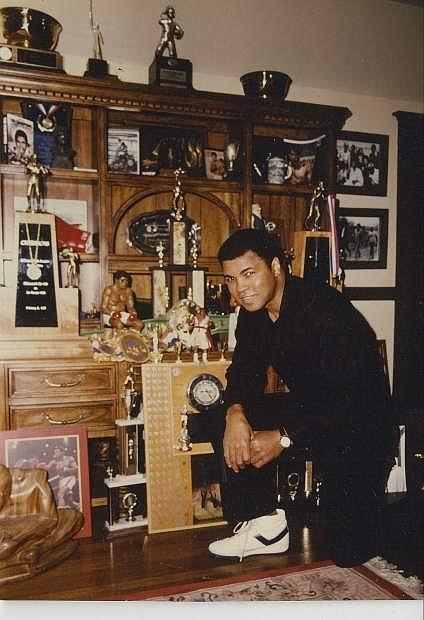 Charles Adams took this photo of Muhammad Ali in Ali's trophy room.