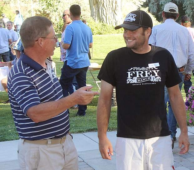 Former Lyon County Sheriff Allen Veil, left, and Colby Frey discuss the wine business.
