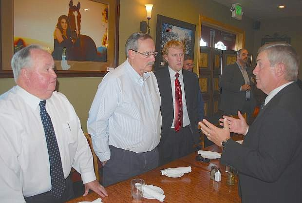 Nevada Supreme Court Judge James Hardesty, right, speaks with Assemblyman Tom Grady, Fallon Mayor Ken Tedford Jr., and assistant City Attorney Robert Erquiaga about the need for an appellate court.
