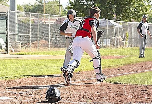 Fallon manager and third-base coach Justin Amos sends T.J. Fagg to score against Sparks in the 14-year-old state tournament in Reno.