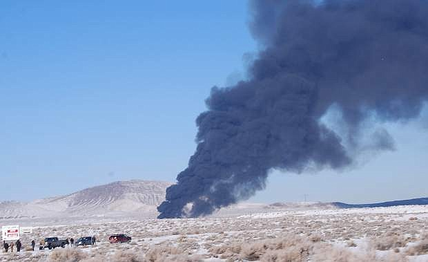 Black smoke could be seen from U.S. Highway 50 just south of Bango.