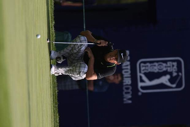 Nick Watney of Dixon, Ca. lines up a putt on the 18th hole at the Barracuda Championship Friday.
