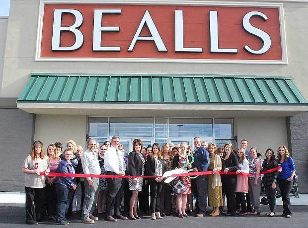 The grqnd opening and ribbon cutting for Bealls Department Store occurred Thursday. Store manager Bethany Hayes, with scissors, prepares to cut the ribbon with Mayor Ken Tedford Jr. to her left, and Natalie Parrish, executive director of the Fallon Chamber of Commerce, to her right. Other chamber members included, second from left, Ava Case, Grant Mills, Doug Drost and Laurel Jackson.