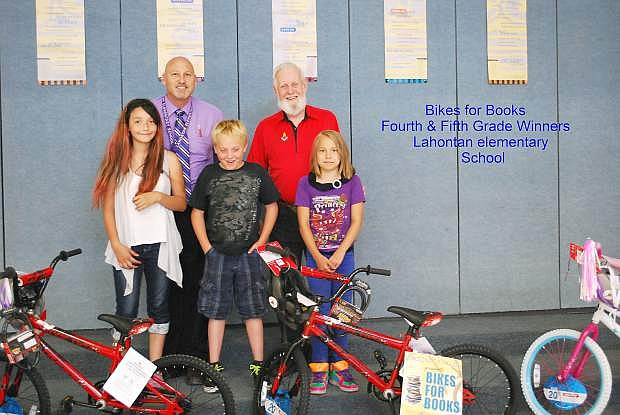 Fourth and winners in the Bikes for Books projects sponsored by Churchill Lodge No 26 and Guardian Lodge No. 53  were, from left, Aliza Stevens, Sam Thorne,  Aurora Rivas and Ethan Hohlt, who was absent on the day of the presentation.They are students at Lahontan Elementary Scholo. In the back are Principal Mike Hogan, left, and Dave Warren, WM, from Churchill Lodge No. 26.