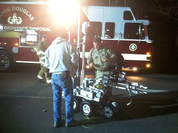 Tahoe Douglas Bomb Squad members work with the bomb robot early Easter morning.