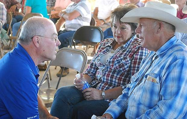 Cliven and Carol Bundy, right, chat with Churchill County commissioner Bus Scharmann  in this Lahontan Valley News file photo.